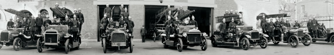Vintage fire trucks and fire men